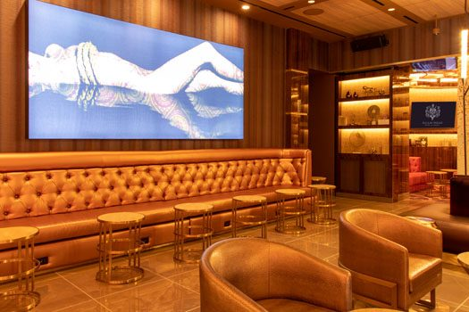 RIght side of CASBAR Lounge with a large painting and comfortable seating