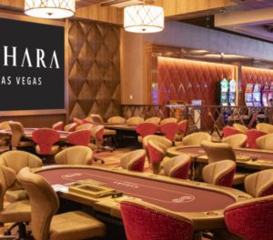Photo of the poker room at SAHARA Las Vegas with poker tables and seating