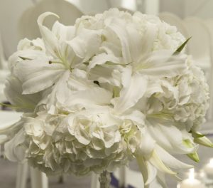 Wedding decor with white flowers and candle setting