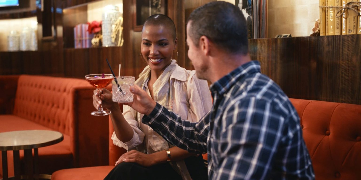 Couple having drinks at CASBAR and toasting