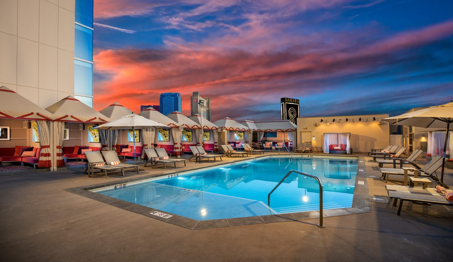 Alexandria Pool at Dusk with cabanas and daybeds