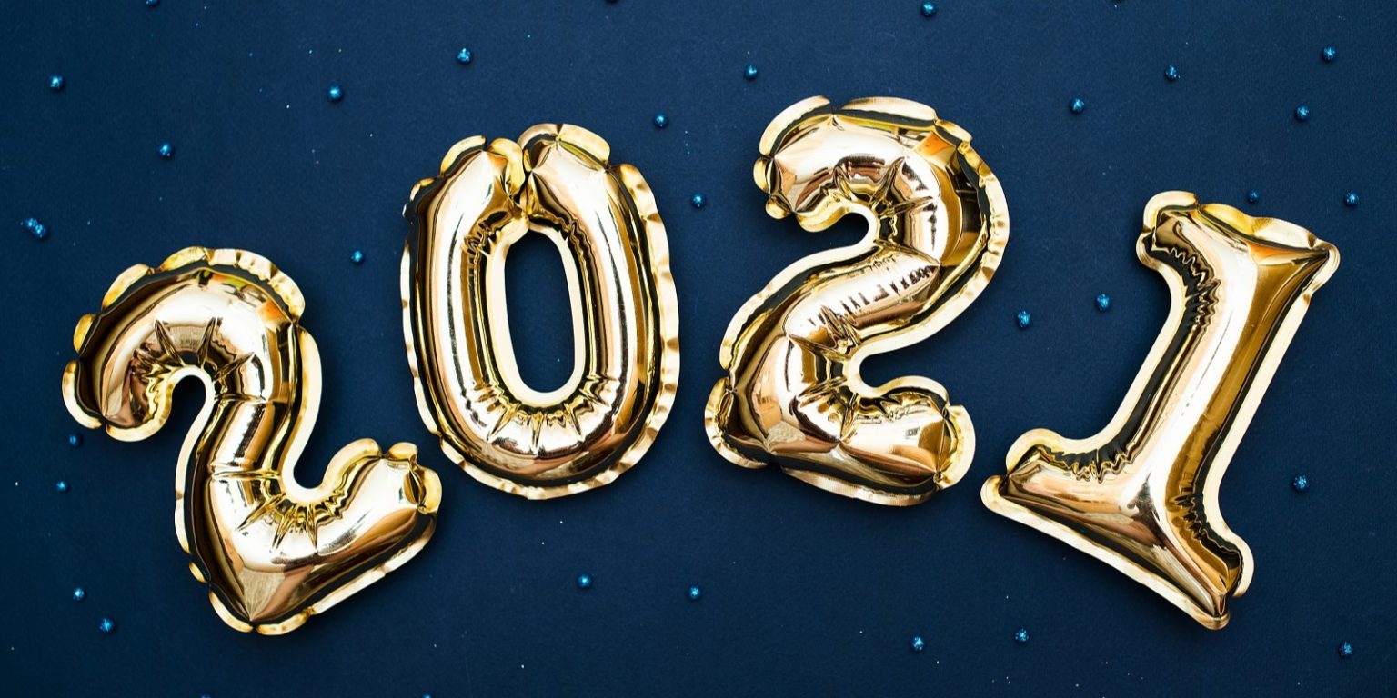 2021 Golden numbers 2021 from new year's balls of yellow metallic color on a blue