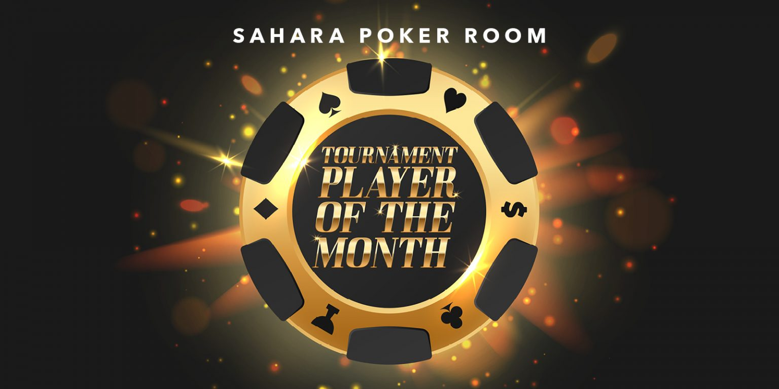 Large poker chip with Tournament Player of the Month copy inside and SAHARA poker room written above the poker chip