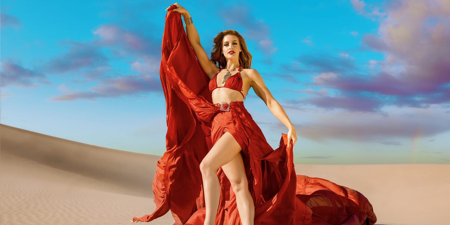 Model in red dress out in the desert