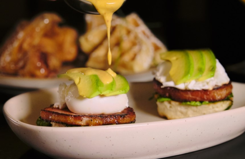 Eggs benedict with cheese on top